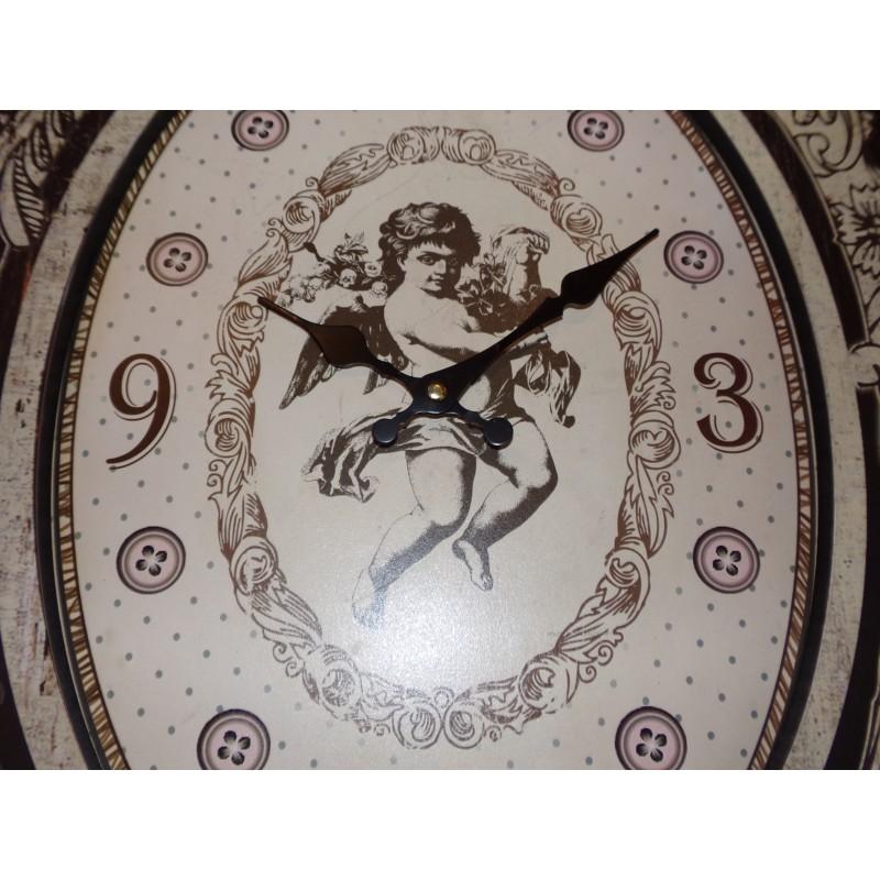 Grande horloge baroque noir et beige décor ange pour un style baroque