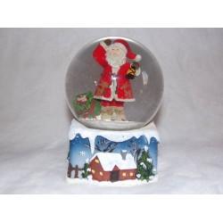 Boite à musique boule de neige décor père noel sac cadeaux portant une lanterne ref 55078